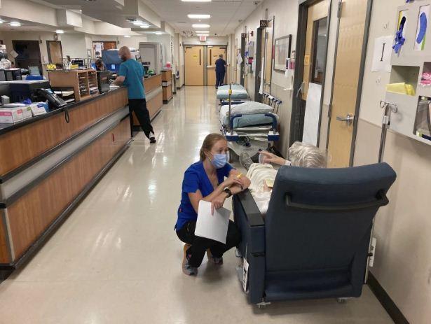 A nurse talks to a patient
